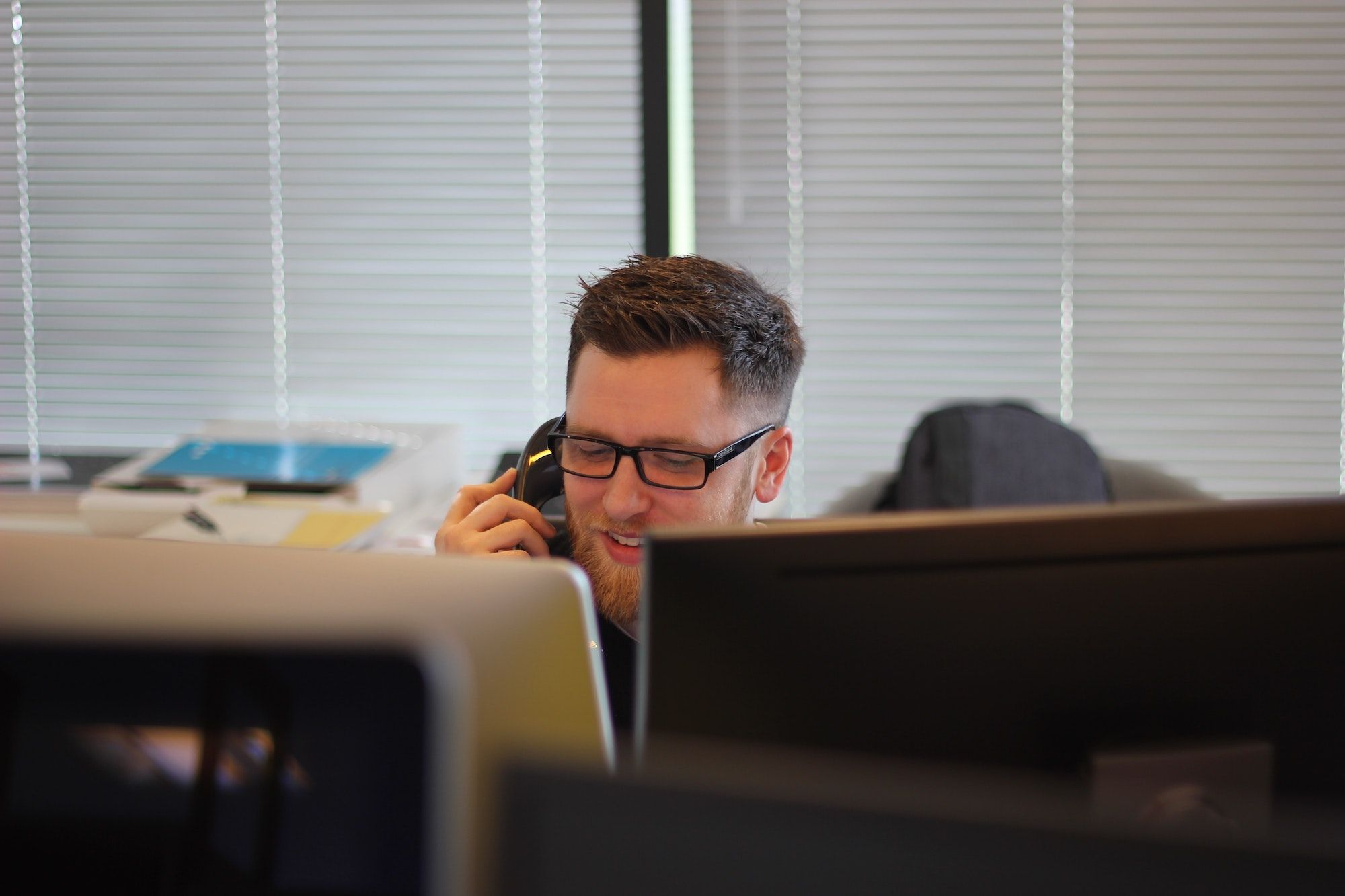 Employee making a phone call using a business VoIP provider